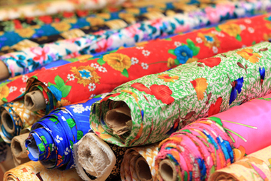 Rolls of silk in shop